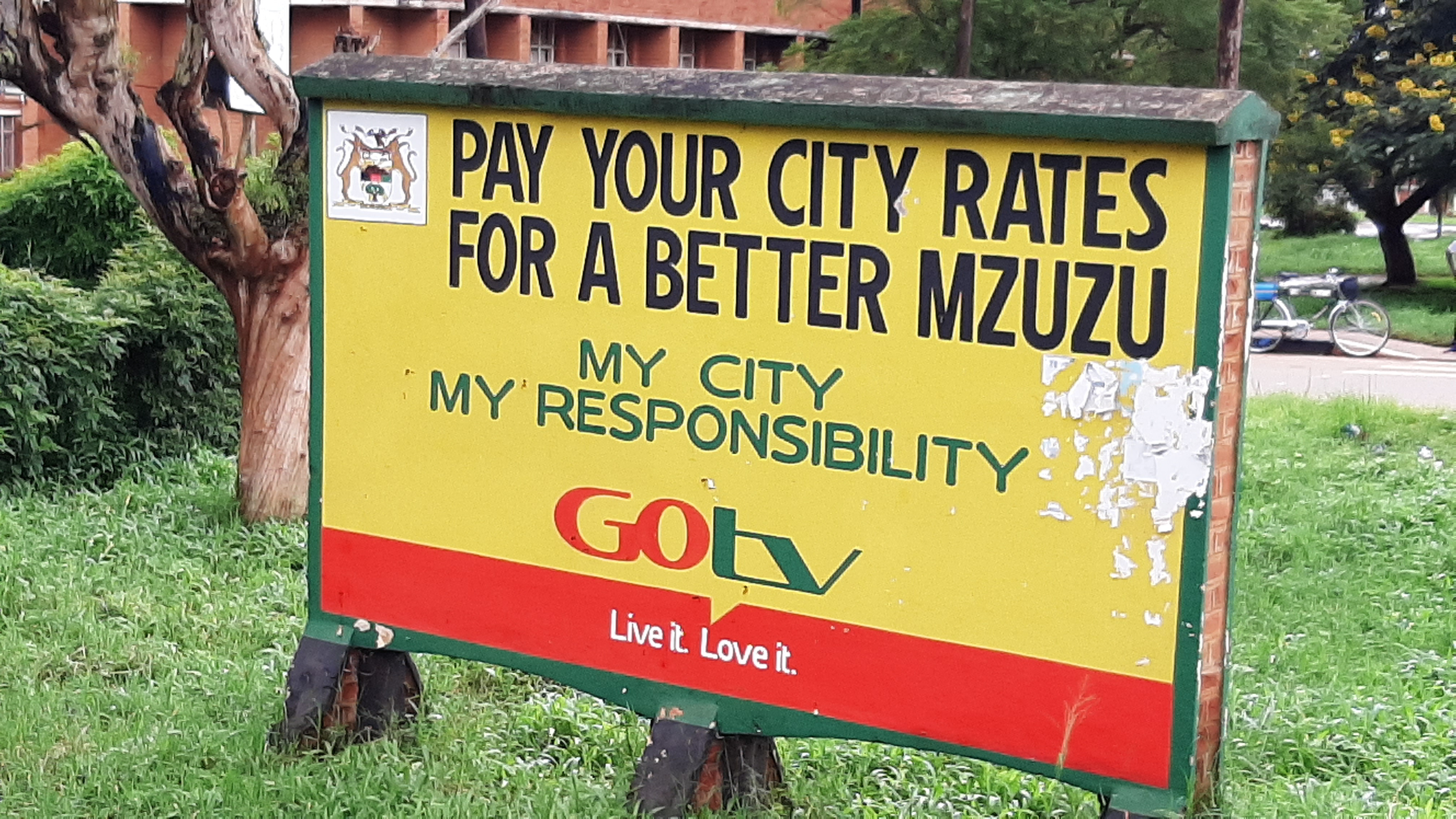 """A sign saying """"Pay your city rates for a better Mzuzu. My city, my responsibility."""