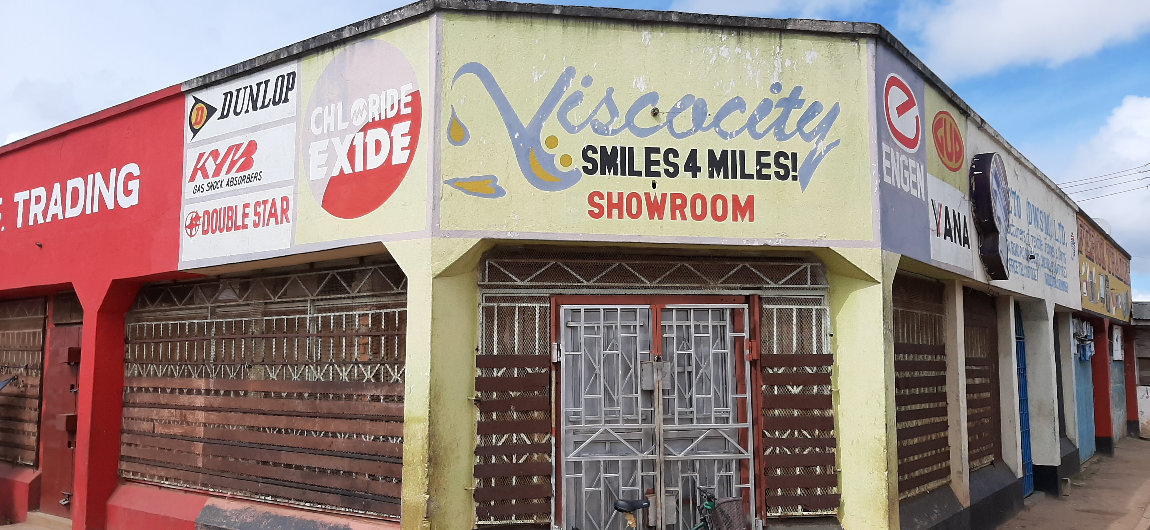 """Shop in Mzuzu, Malawi with """"Viscocity smiles for miles"""" painted on it"""